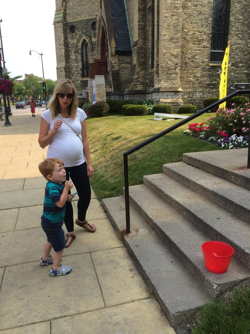 Blowing bubbles in front of church